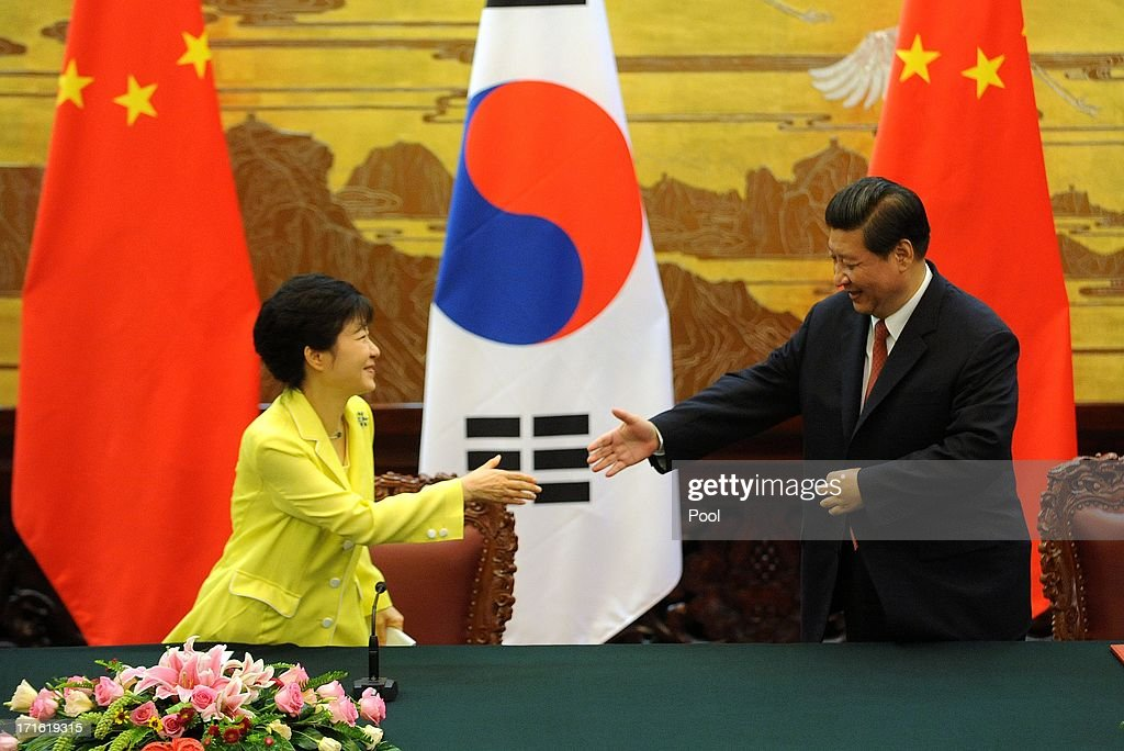 South Korean President Park Geun-Hye (L) and Chinese President <a gi-track='captionPersonalityLinkClicked' href=/galleries/search?phrase=Xi+Jinping&family=editorial&specificpeople=2598986 ng-click='$event.stopPropagation()'>Xi Jinping</a> attend a joint declaration ceremony at the Great Hall of the People on June 27, 2013 in Beijing, China. Park Geun-Hye is visiting China from June 27 to 30.