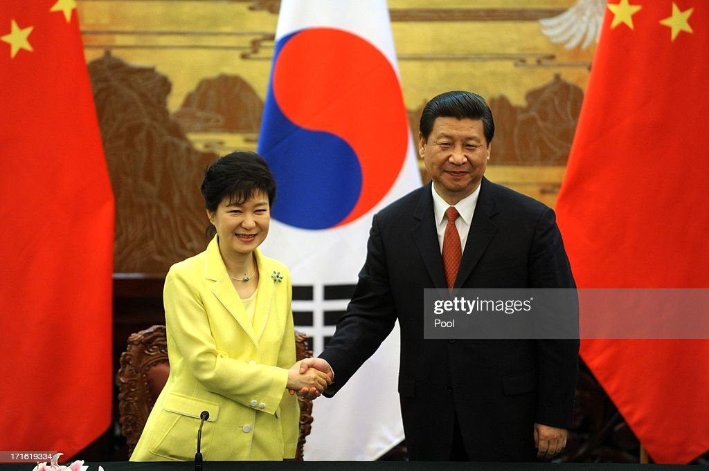 South Korean President Park Geun-Hye (L) and Chinese President Xi Jinping attend a joint declaration ceremony at the Great Hall of the People on June 27, 2013 in Beijing, China. Park Geun-Hye is visiting China from June 27 to 30.