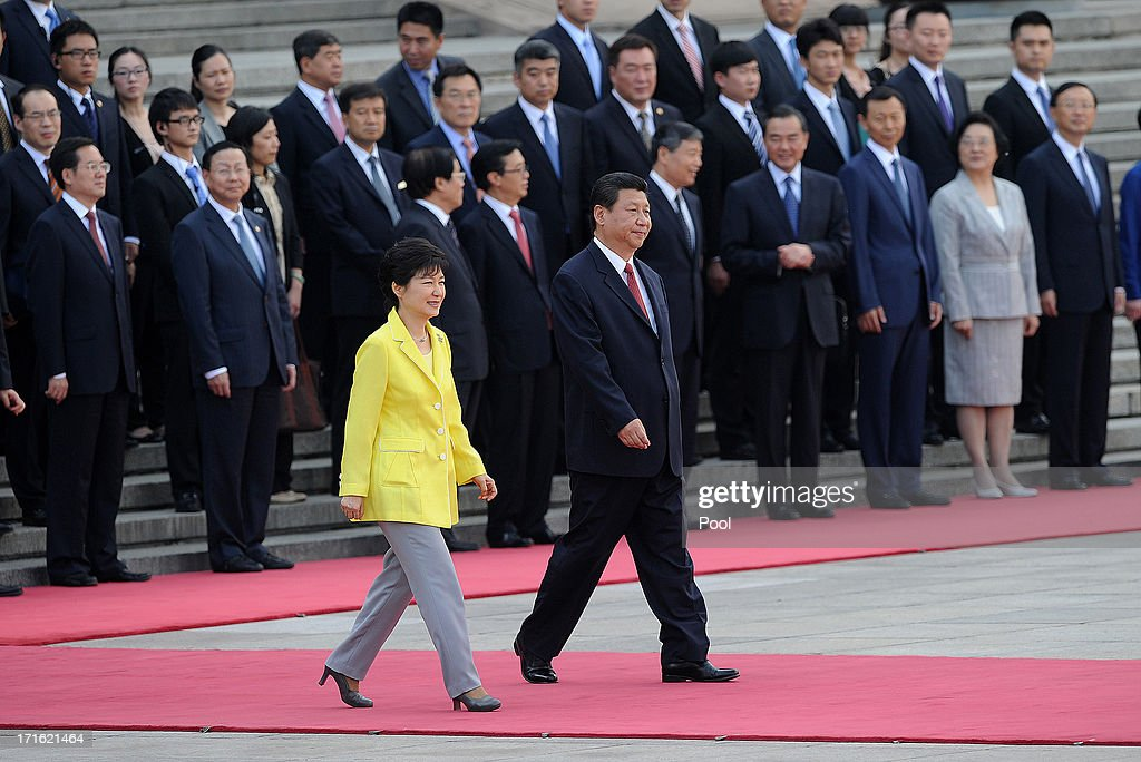 South Korean President Park Geun-Hye (L) and Chinese President <a gi-track='captionPersonalityLinkClicked' href=/galleries/search?phrase=Xi+Jinping&family=editorial&specificpeople=2598986 ng-click='$event.stopPropagation()'>Xi Jinping</a> prepare to inspect Chinese honour guards during a welcoming ceremony outside the Great Hall of the People on June 27, 2013 in Beijing, China. Park Geun-Hye is visiting China from June 27 to 30.
