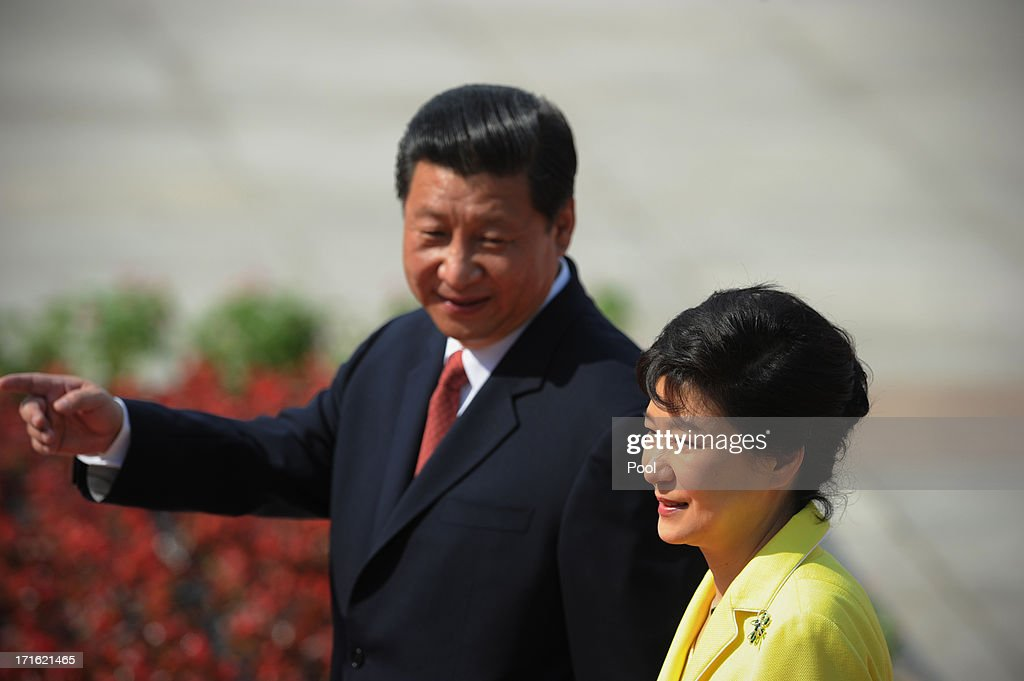 South Korean President Park Geun-Hye (R) and Chinese President Xi Jinping inspect Chinese honour guards during a welcoming ceremony outside the Great Hall of the People on June 27, 2013 in Beijing, China. Park Geun-Hye is visiting China from June 27 to 30.