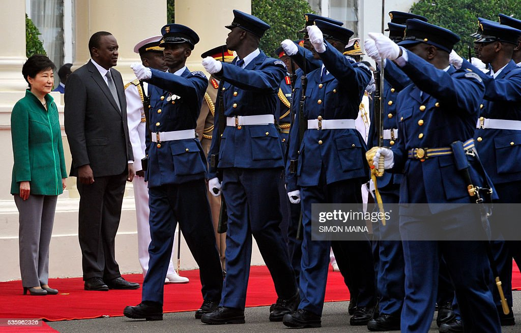 South Korean President Park Geun-hye (L) and her Kenyan counterpart Uhuru Kenyatta (2L) looks at the Kenya Airforce marching May 31, 2016 at the StateHouse in Nairobi, during the first state visit by a South Korean president to the country in 34 years. / AFP / SIMON