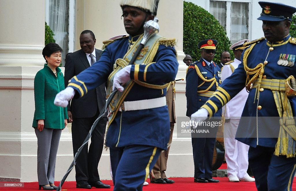 South Korean President Park Geun-hye (L) and her Kenyan counterpart Uhuru Kenyatta (2L) look at the Kenya Airforce marching May 31, 2016 at the State House in Nairobi, during the first state visit by a South Korean president to the country in 34 years. / AFP / SIMON