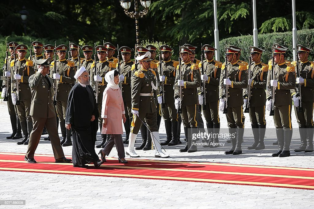 South Korean President Park Geun-Hye (R) and Iran's President Hassan Rouhani (L) walk past the honor guards during an official welcoming ceremony at Sadabad Palace in Tehran, Iran on May 2, 2016.