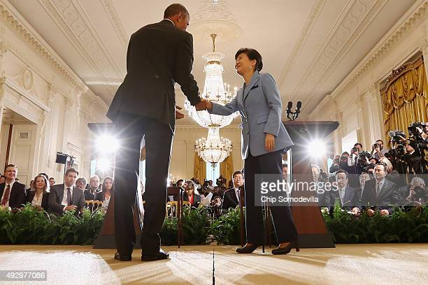 South Korean President Park Geunhye and US President Barack Obama shake hands at the conclusion of a joint press conference in the East Room of the...