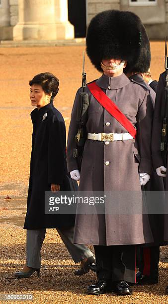 South Korean President Park GeunHye attends a ceremonial welcome on Horse Guards in central London on November 5 2013 President Park GeunHye began a...