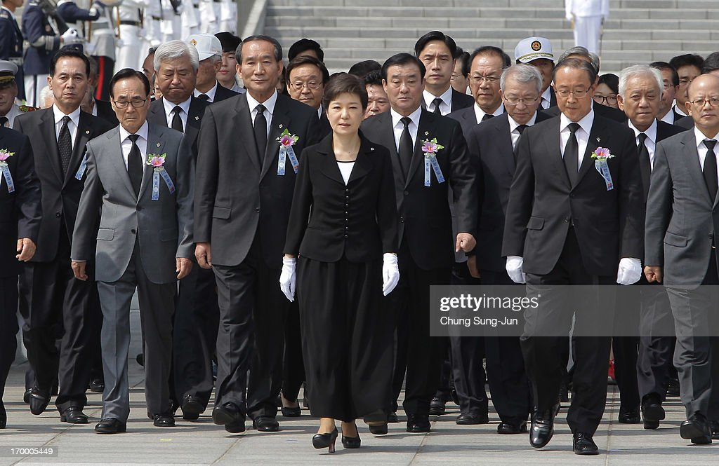 South Korean President Park Geun-Hye (C) attends during a ceremony marking Korean Memorial Day at the Seoul National Cemetery on June 6, 2013 in Seoul, South Korea. South Korea today marks the 58th anniversary of the Memorial Day for those killed in the 1950-53 Korean War.