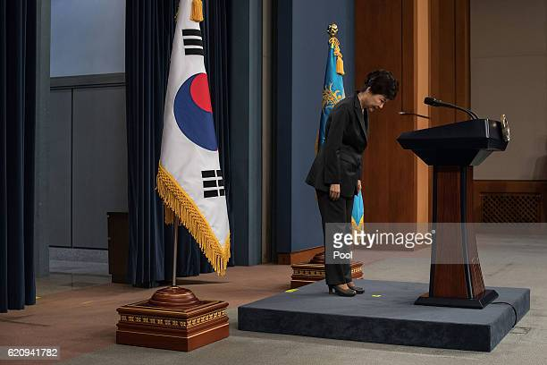 South Korean President Park GeunHye bows prior to delivering an address to the nation at the presidential Blue House on November 4 2016 in Seoul...