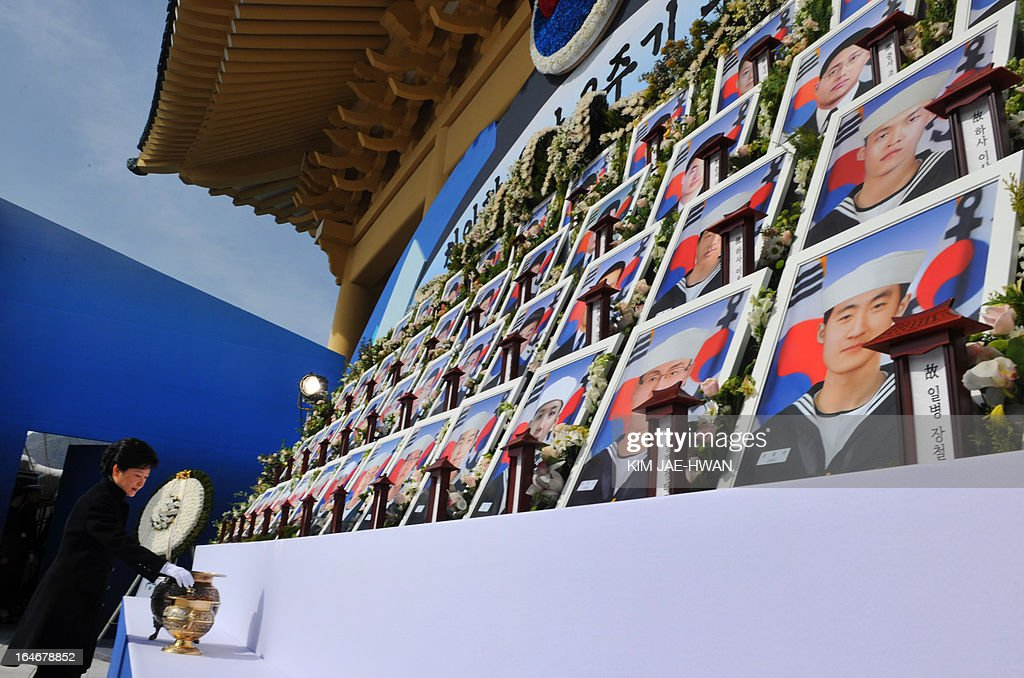 South Korean President Park Geun-Hye (L) burns incense before an altar with pictures of the 46 sailors who died in 2010 when the naval vessel 'Cheonan' was sunk, during a ceremony in the central city of Daejeon on March 26, 2013. Forty-six sailors died after the naval vessel Cheonan was sunk by what Seoul insists was a North Korean submarine. Addressing a ceremony for the 46 sailors, South Korean President Park Geun-Hye warned Pyongyang that its only 'path to survival' lay in abandoning its nuclear and missile programs.