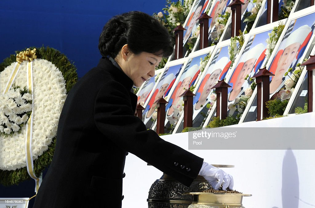 South Korean President Park Geun-Hye burns incense during a memorial ceremony to commemorate the victims of Cheonan warship sinking at the National Ceremtery on March 26, 2013 in Daejeon, South Korea. The warship exploded and sank, later found the fact that North Korea torpedoed, though Pyongyang denied, killed 46 sailors.