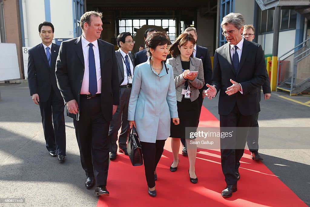 South Korean President Park Geun-hye (C) chats with Siemens AG CEO Joe Kaeser (R) and Siemens Energy Sector CEO Michael Suess (L) during a tour of the Siemens gas turbine factory on March 27, 2014 in Berlin, Germany. President Park is on a two-day visit to the German capital.