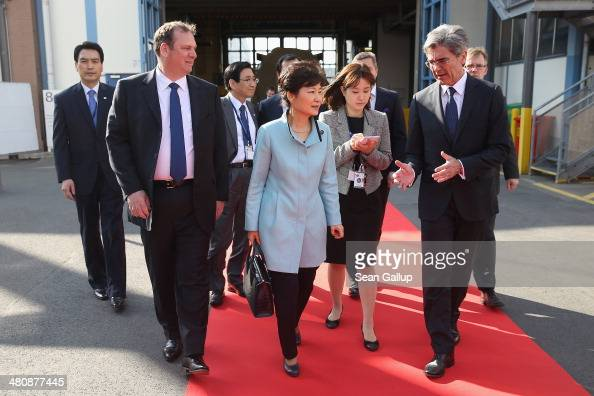 South Korean President Park Geunhye chats with Siemens AG CEO Joe Kaeser and Siemens Energy Sector CEO Michael Suess during a tour of the Siemens gas...