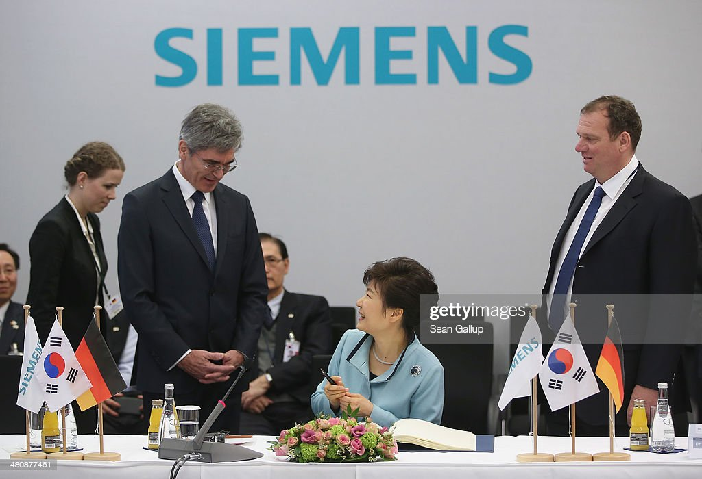 South Korean President <a gi-track='captionPersonalityLinkClicked' href=/galleries/search?phrase=Park+Geun-hye&family=editorial&specificpeople=603075 ng-click='$event.stopPropagation()'>Park Geun-hye</a> (C) chats with Siemens AG CEO <a gi-track='captionPersonalityLinkClicked' href=/galleries/search?phrase=Joe+Kaeser&family=editorial&specificpeople=558326 ng-click='$event.stopPropagation()'>Joe Kaeser</a> (L) and Siemens Energy Sector CEO Michael Suess (R) after she signed a guest book during a tour of the Siemens gas turbine factory on March 27, 2014 in Berlin, Germany. President Park is on a two-day visit to the German capital.