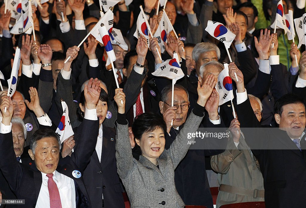 South Korean President Park Geun-hye (bottom C) cheers as she holds a national flag during a ceremony to celebrate the March 1 Independence Movement Day, the anniversary of the 1919 uprising against Japanese colonial rule, in Seoul on March 1, 2013. South Koreans celebrate the public holiday of remembrance to mark the 1919 civilian uprising against Japanese colonial rule from 1910-1945.