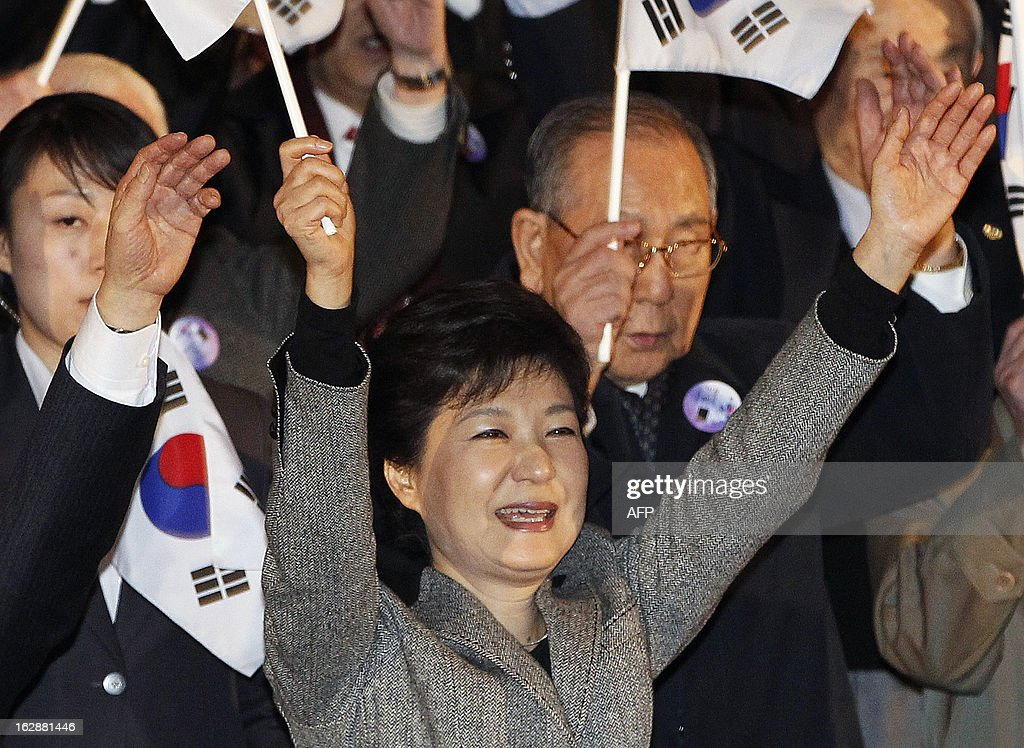 South Korean President Park Geun-hye (C) cheers as she holds a national flag during a ceremony to celebrate the March 1 Independence Movement Day, the anniversary of the 1919 uprising against Japanese colonial rule, in Seoul on March 1, 2013. South Koreans celebrate the public holiday of remembrance to mark the 1919 civilian uprising against Japanese colonial rule from 1910-1945.