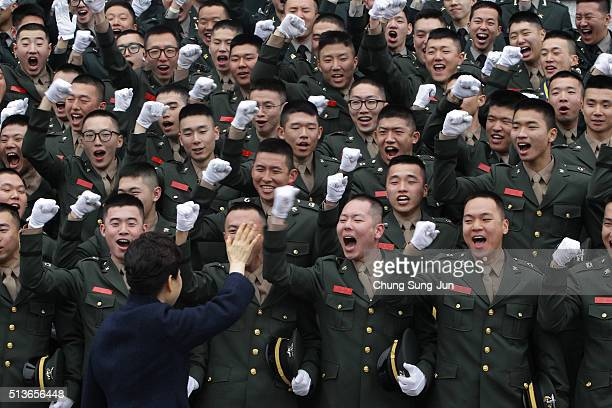 South Korean President Park GeunHye cheers with new military officers during a military commissioning ceremony at Gyeryongdae South Korea's main...