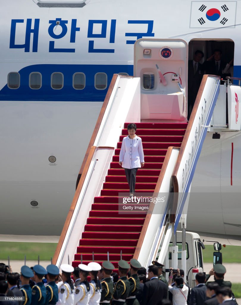 South Korean President Park Geun-Hye disembarks the plane upon landing at Beijing Capital International Airport on June 27, 2013 in Beijing, China. Park Geun-Hye is on a four-day visit to China.