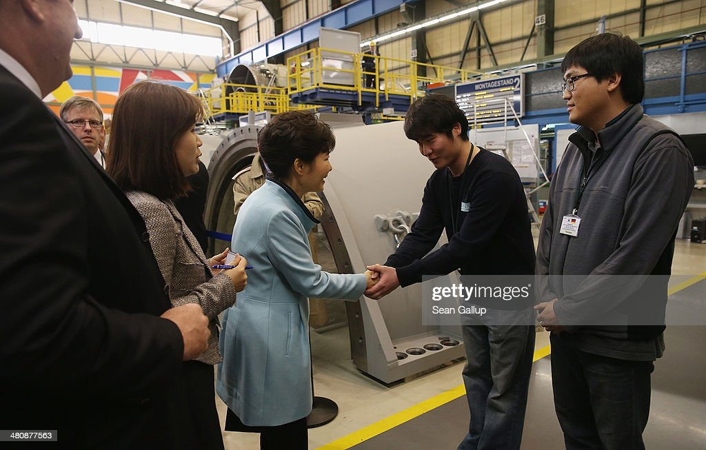 South Korean President <a gi-track='captionPersonalityLinkClicked' href=/galleries/search?phrase=Park+Geun-hye&family=editorial&specificpeople=603075 ng-click='$event.stopPropagation()'>Park Geun-hye</a> (C) greets South Korean Siemens employees while visiting the Siemens gas turbine factory on March 27, 2014 in Berlin, Germany. President <a gi-track='captionPersonalityLinkClicked' href=/galleries/search?phrase=Park+Geun-hye&family=editorial&specificpeople=603075 ng-click='$event.stopPropagation()'>Park Geun-hye</a> is on a two-day visit to the German capital.