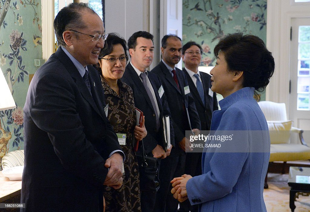 South Korean President Park Geun-Hye (R) greets World Bank president Jim Young Kim (L) and his delegation before a meeting at the Blair House in Washington on May 7, 2013. The leaders of the United States and South Korea vowed no concessions to North Korea after months of high tension, saying the burden was on the communist state to end the crisis. In a choreographed show of unity, US President Barack Obama and Park pledged to bolster defense cooperation and demanded that North Korea change course on its nuclear program before any new talks. AFP PHOTO/Jewel Samad