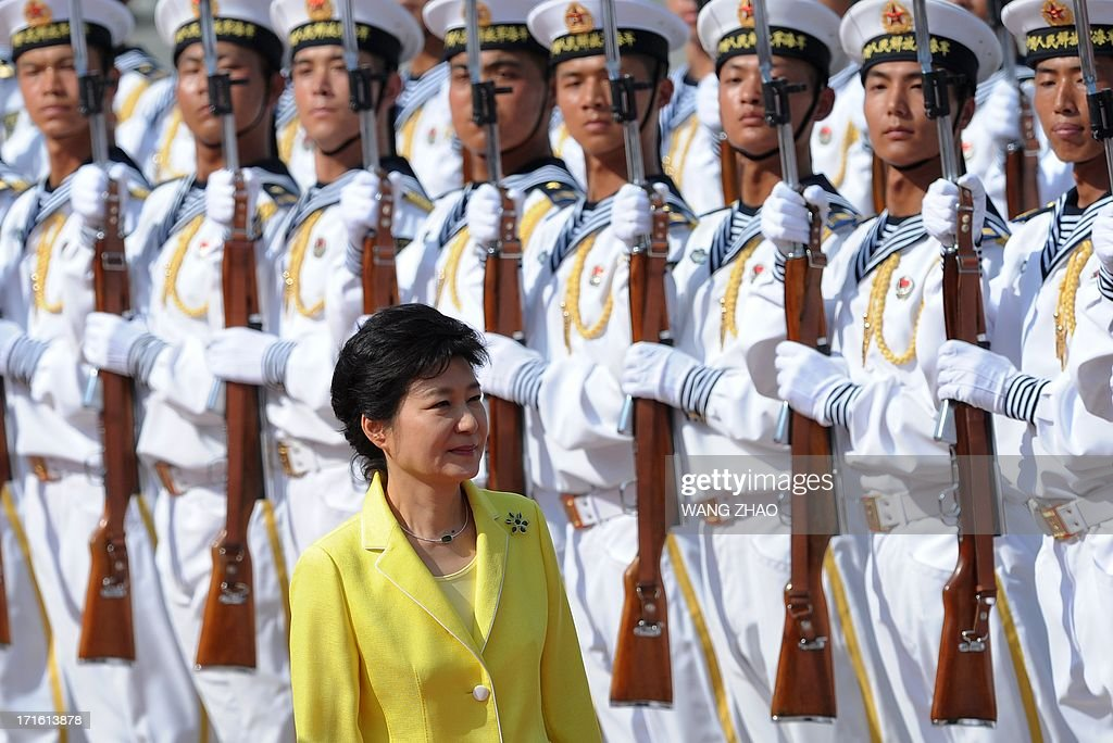 South Korean President Park Geun-Hye inspects Chinese honour guards during a welcoming ceremony outside the Great Hall of the People in Beijing on June 27, 2013. Park Geun-Hye is on a visit to China from June 27 to 30.