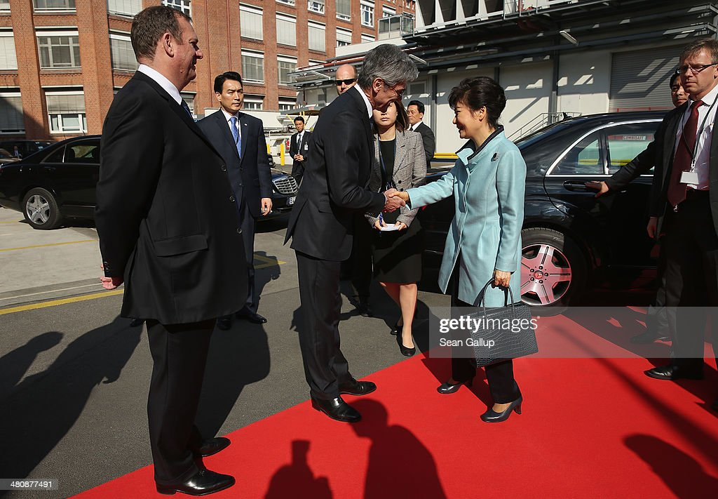 South Korean President <a gi-track='captionPersonalityLinkClicked' href=/galleries/search?phrase=Park+Geun-hye&family=editorial&specificpeople=603075 ng-click='$event.stopPropagation()'>Park Geun-hye</a> (R) is greeted by Siemens AG CEO <a gi-track='captionPersonalityLinkClicked' href=/galleries/search?phrase=Joe+Kaeser&family=editorial&specificpeople=558326 ng-click='$event.stopPropagation()'>Joe Kaeser</a> (C) and Siemens Energy Sector CEO Michael Suess (L) upon her arrival to visitf the Siemens gas turbine factory on March 27, 2014 in Berlin, Germany. President Park is on a two-day visit to the German capital.