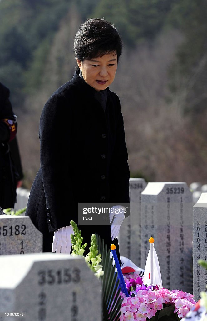 South Korean President Park Geun-Hye looks at the graves during a memorial ceremony to commemorate the victims of Cheonan warship sinking at the National Ceremtery on March 26, 2013 in Daejeon, South Korea. The warship exploded and sank, later found the fact that North Korea torpedoed, though Pyongyang denied, killed 46 sailors.