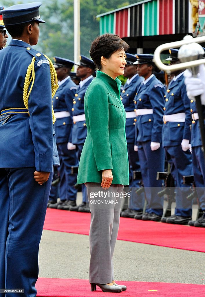 South Korean President Park Geun-hye looks at the Kenya Airforce marching May 31, 2016 at the State House in Nairobi, during the first state visit by a South Korean president to the country in 34 years. / AFP / SIMON