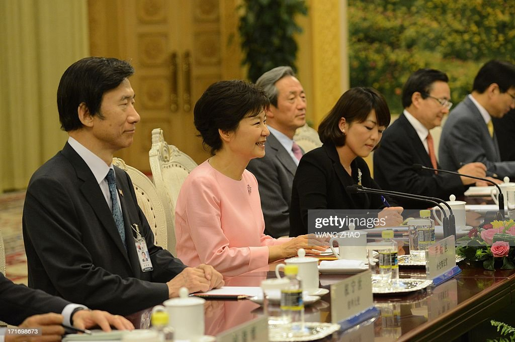 South Korean President Park Geun-Hye (2nd L) meets with Chinese Chairman of the National People's Congress Zhang Dejiang (not in picture) at the Great Hall of the People in Beijing on June 28