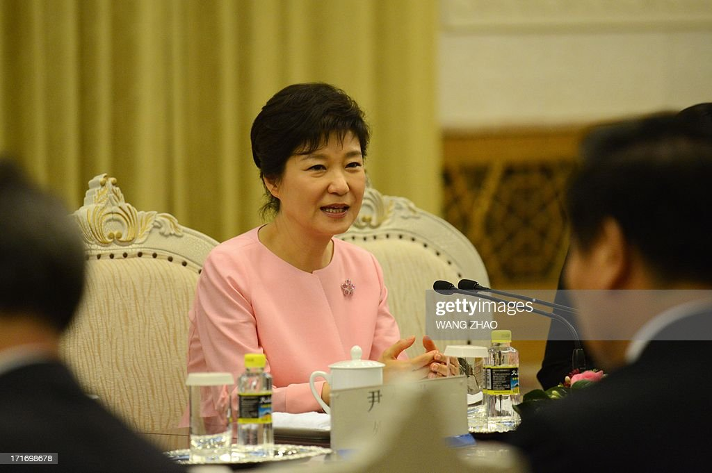 South Korean President Park Geun-Hye (C) meets with Chinese Chairman of the National People's Congress Zhang Dejiang (not in picture) at the Great Hall of the People in Beijing on June 28. Park Geun-Hye is on a visit to China from June 27 to 30. AFP PHOTO / POOL / WANG ZHAO
