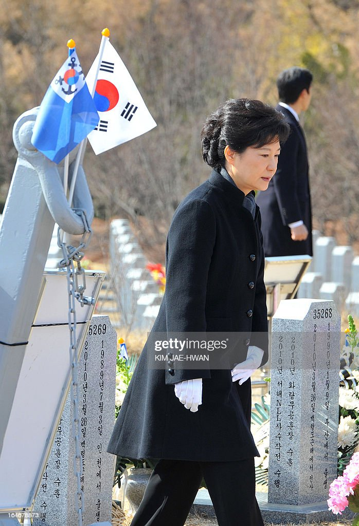 South Korean President Park Geun-Hye pays homage to the sailors who died in 2010 when the naval vessel 'Cheonan' was sunk, during a ceremony at a cemetery in the central city of Daejeon on March 26, 2013. Forty-six sailors died after the naval vessel Cheonan was sunk by what Seoul insists was a North Korean submarine. Addressing a ceremony for the 46 sailors, South Korean President Park Geun-Hye warned Pyongyang that its only 'path to survival' lay in abandoning its nuclear and missile programs.