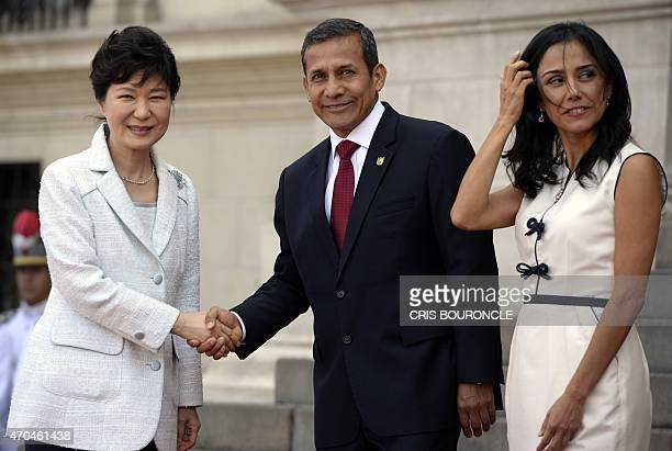South Korean President Park GeunHye poses for photographers with Peruvian President Ollanta Humala and his wife Nadine Heredia upon her arrival at...
