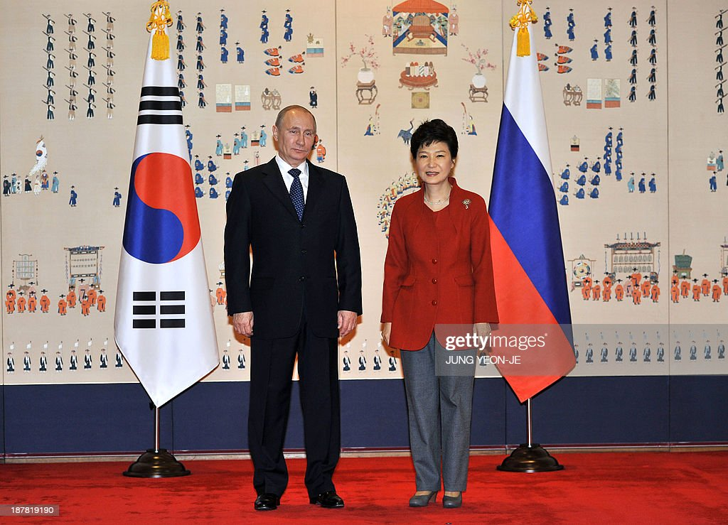 South Korean President Park Geun-Hye (R) poses with Russian President Vladimir Putin (L) at the presidential Blue House in Seoul on November 13, 2013. Russian President Vladimir Putin was in South Korea on November 13 to push a pet project for a new major trading route linking Asia and Europe by rail that requires prying open North Korea.