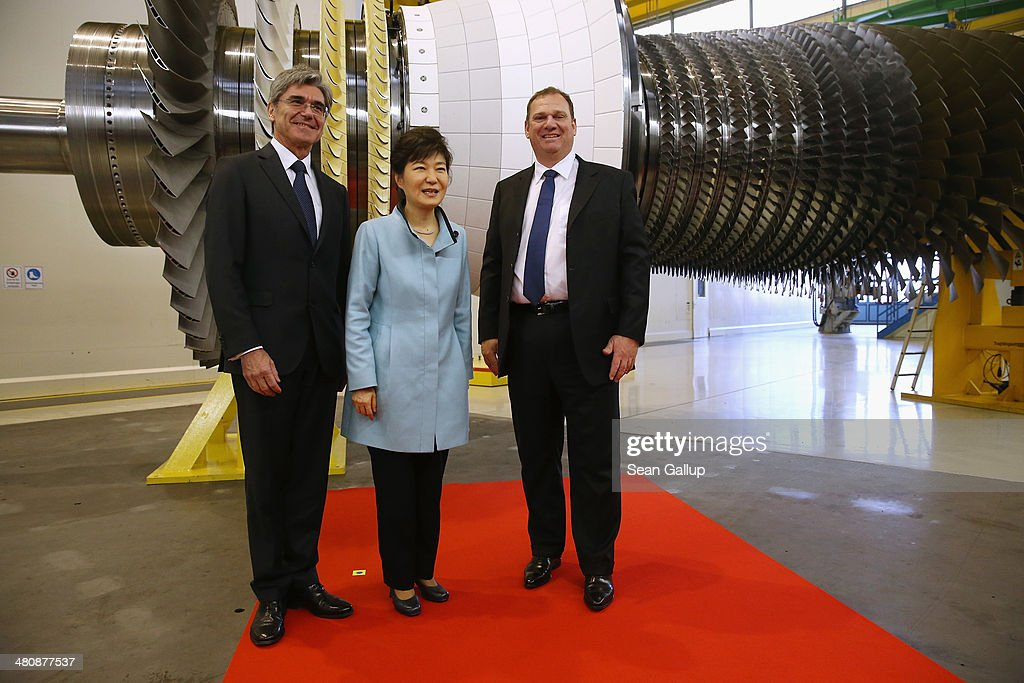 South Korean President Park Geun-hye (C) poses with Siemens AG CEO Joe Kaeser (L) and Siemens Energy Sector CEO Michael Suess (R) while visiting the Siemens gas turbine factory on March 27, 2014 in Berlin, Germany. President Park is on a two-day visit to the German capital.