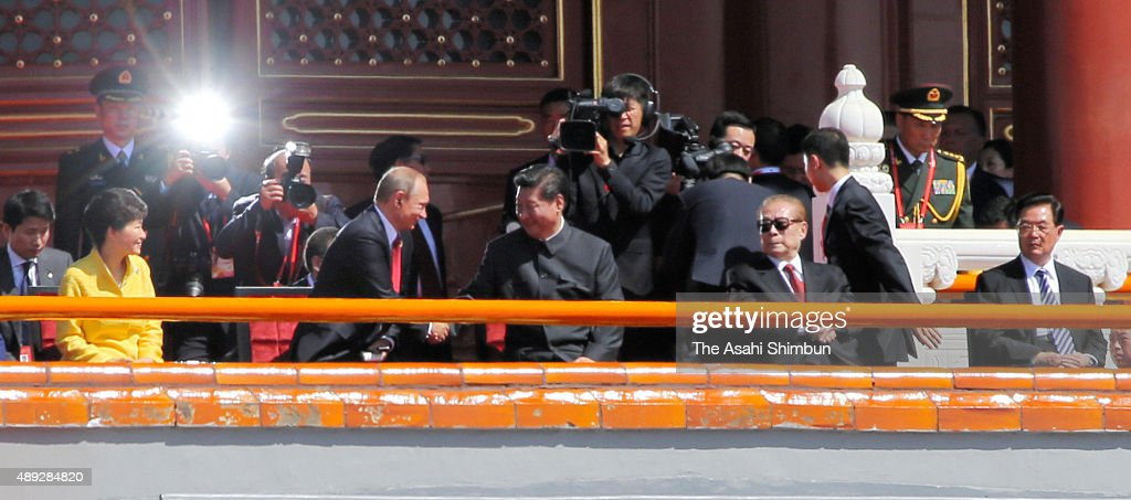 South Korean President Park Geun-hye, Russian President Vladimir Putin, Chinese President Xi Jinping, former presidents Jiang Zemin and Hu Jintao attend a military parade on September 3, 2015 in Beijing, China. China is marking the 70th anniversary of the end of World War II and its role in defeating Japan with a new national holiday and a military parade in Beijing.