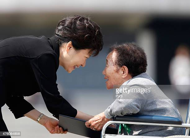 South Korean President Park Geunhye shakes hands with a national meritorious woman during the 60th Memorial Day on June 6 2015 in Seoul South Korea...