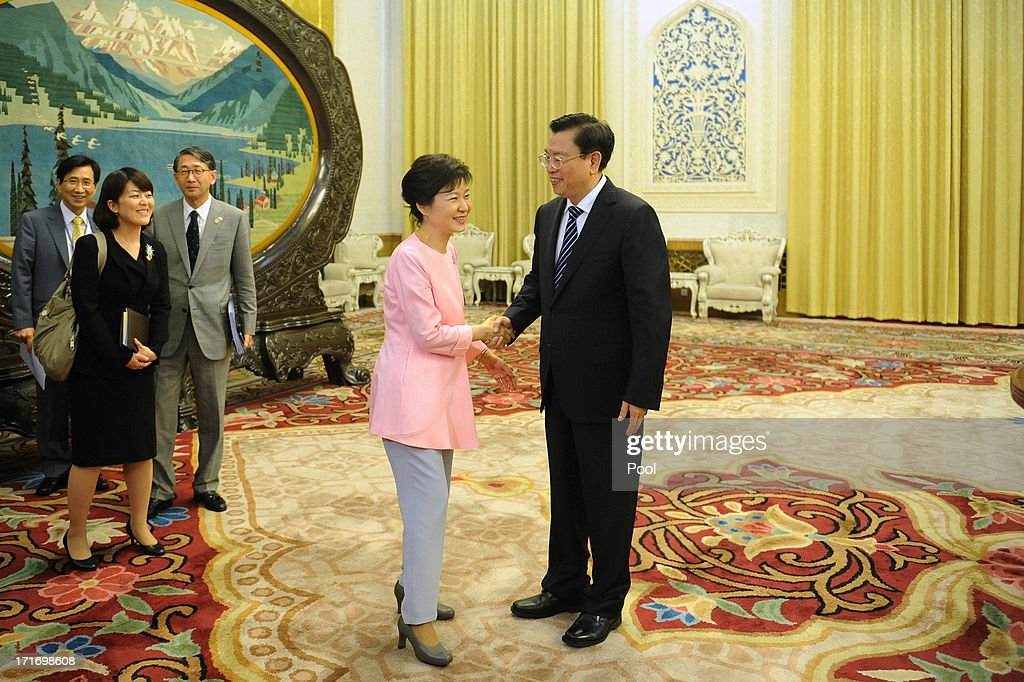 South Korean President Park Geun-Hye shakes hands with Chinese Chairman of the National People's Congress Zhang Dejiang at the Great Hall of the People on June 28, 2013 in Beijing, China. South Korean President Park Geun-Hye is on a four-day visit to China.