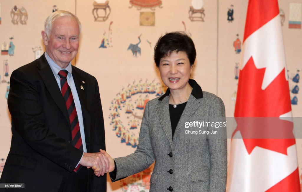 South Korean President Park Geun-Hye shakes hands with David Johnston, the governor of Canada during their meeting at presidential house on February 26, 2013 in Seoul, South Korea. Park Geun-Hye, daughter of former president Park Chung-Hee, is the first female president of South Korea. Park engaged in a flurry of diplomacy on her second day in office, holding meetings with World leaders.