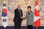 South Korean President Park GeunHye shakes hands with David Johnston the governor of Canada during their meeting at presidential house on February 26...