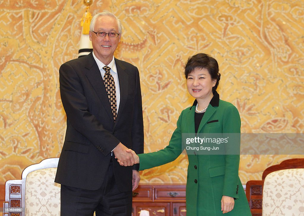 South Korean President Park Geun-Hye (R) shakes hands with <a gi-track='captionPersonalityLinkClicked' href=/galleries/search?phrase=Goh+Chok+Tong&family=editorial&specificpeople=217960 ng-click='$event.stopPropagation()'>Goh Chok Tong</a>, Senior Minister and former Prime Minister of Singapore after inauguration ceremony at presidential house on February 25, 2013 in Seoul, South Korea. Park, the daughter of former Republic of Korea Army general and dictator from 1961 to 1979 Park Chung-hee, was today sworn in as the first female president of South Korea.