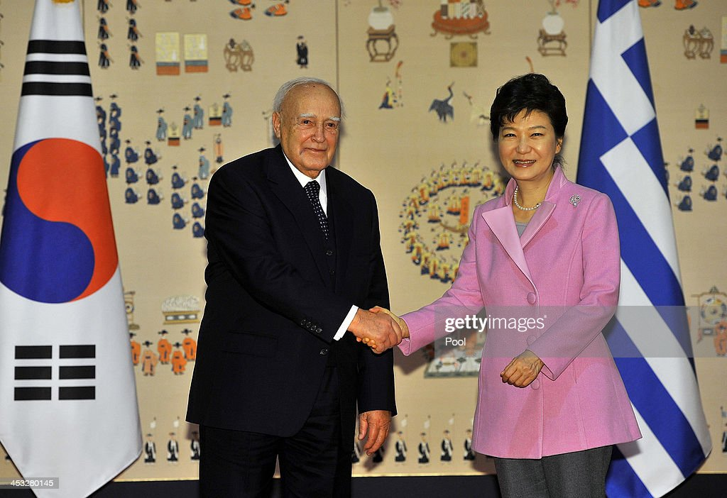 South Korean President Park Geun-Hye (R) shakes hands with Greek President Karolos Papoulias (L) during their meeting at the presidential Blue House in Seoul on December 3, 2013. Greece and South Korea met to discuss economic exchanges and to strengthen bilateral relationships in trade, culture and diplomacy.