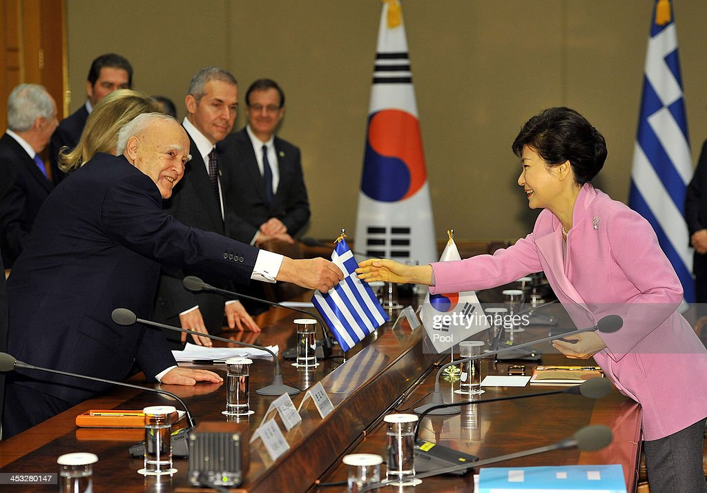 South Korean President Park Geun-Hye (R) shakes hands with Greek President <a gi-track='captionPersonalityLinkClicked' href=/galleries/search?phrase=Karolos+Papoulias&family=editorial&specificpeople=743016 ng-click='$event.stopPropagation()'>Karolos Papoulias</a> (L) during their meeting at the presidential Blue House in Seoul on December 3, 2013. Greece and South Korea met to discuss economic exchanges and to strengthen bilateral relationships in trade, culture and diplomacy.