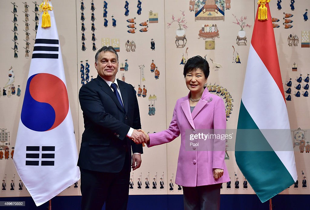 South Korean President Park Geun-Hye (R) shakes hands with Hungarian Prime Minister <a gi-track='captionPersonalityLinkClicked' href=/galleries/search?phrase=Viktor+Orban&family=editorial&specificpeople=4685765 ng-click='$event.stopPropagation()'>Viktor Orban</a> (L) during their meeting at the presidential Blue House on November 28, 2014 in Seoul, South Korea. Prime Minister of Hungary Orban Viktor is visiting South Korea from November 27 to 29.