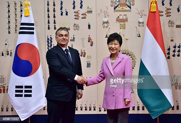 South Korean President Park GeunHye shakes hands with Hungarian Prime Minister Viktor Orban during their meeting at the presidential Blue House on...