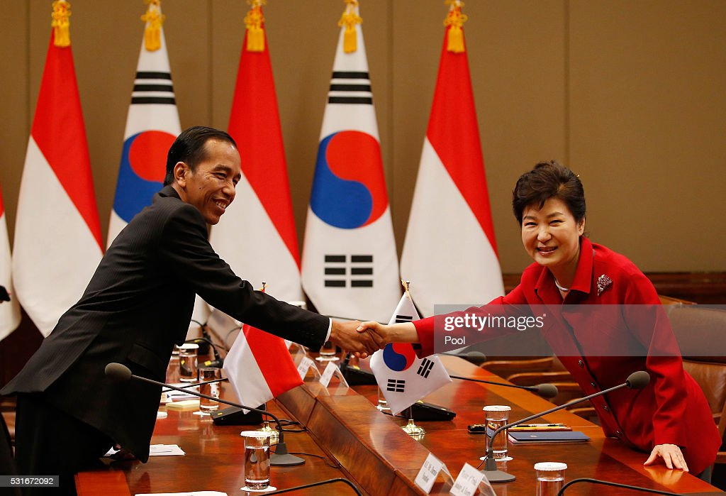 South Korean President Park Geun-Hye (R) shakes hands with Indonesian President Joko Widodo (L) during their meeting at the presidential Blue House on May 16, 2016 in Seoul, South Korea. Indonesian President Joko Widodo is visiting South Korea from May 15 to May 18 and meets with South Korean counterpart Park Geun-hye to discuss cooperation in trade investment and other regional and international issues.