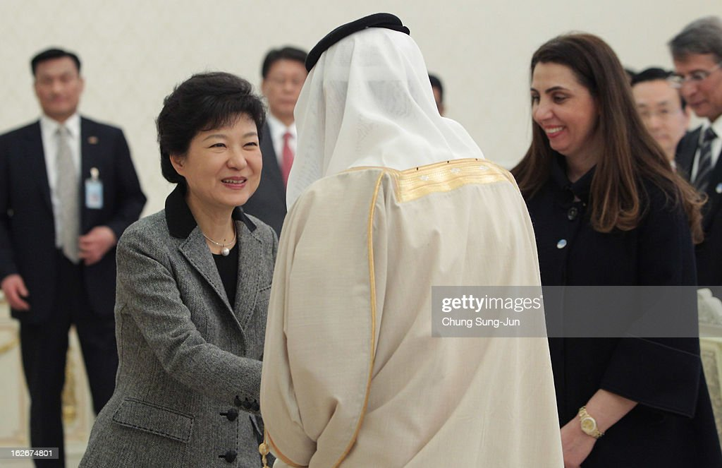 South Korean President Park Geun-Hye (L) shakes hands with Masaad Bin Mohamed Al-Aiban (C) Minister of Foreign Trade of Saudi Arabia as Rola Abdullah Dashti (R) Minister of Planning and Development of Kuwait stand during their meeting at presidential house on February 26, 2013 in Seoul, South Korea. Park Geun-Hye, daughter of former president Park Chung-Hee, the first female president of South Korea. Park engaged in a flurry of diplomacy on her second day in office, holding meetings with World leaders.