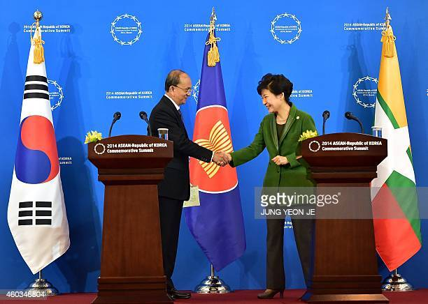 South Korean President Park GeunHye shakes hands with Myanmar President Thein Sein during a joint press conference after the ASEANRepublic of Korea...