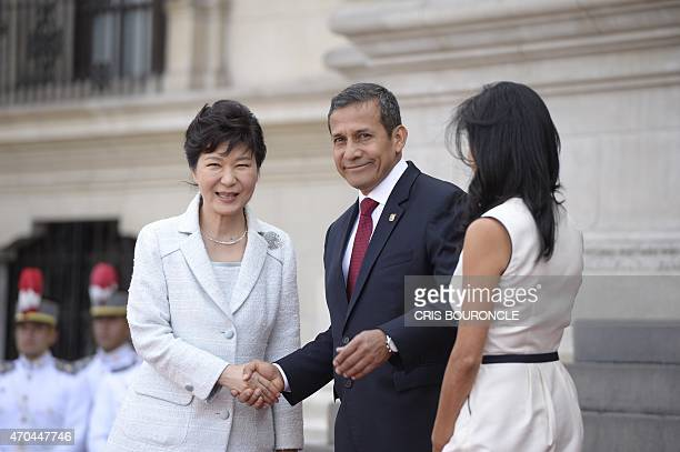 South Korean President Park Geunhye shakes hands with Peruvian President Ollanta Humala next to his wife Nadine Heredia during her official visit in...