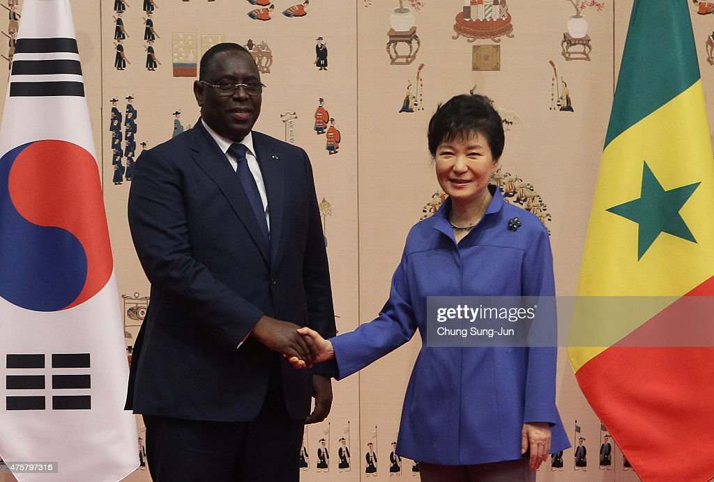 South Korean President Park Geun-Hye (R) shakes hands with Senegal President <a gi-track='captionPersonalityLinkClicked' href=/galleries/search?phrase=Macky+Sall&family=editorial&specificpeople=598630 ng-click='$event.stopPropagation()'>Macky Sall</a> (L) prior to their meeting at the presidential blue house on June 4, 2015 in Seoul, South Korea. The Senegal President <a gi-track='captionPersonalityLinkClicked' href=/galleries/search?phrase=Macky+Sall&family=editorial&specificpeople=598630 ng-click='$event.stopPropagation()'>Macky Sall</a> is on trip to South Korea to discuss the two countries strategic partnership.