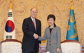 South Korean President Park GeunHye shakes hands with Thomas Donilon National Security advisor of United States during their meeting at presidential...