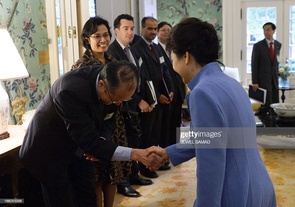 South Korean President Park Geun-Hye (R) shakes hands with World Bank president Jim Young Kim (L) before a meeting at the Blair House in Washington on May 7, 2013. The leaders of the United States and South Korea vowed no concessions to North Korea after months of high tension, saying the burden was on the communist state to end the crisis. In a choreographed show of unity, US President Barack Obama and Park pledged to bolster defense cooperation and demanded that North Korea change course on its nuclear program before any new talks. AFP PHOTO/Jewel Samad