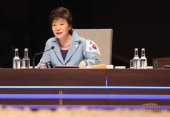 South Korean President Park Geunhye speaks at the opening plenary session of the 2014 Nuclear Security Summit on March 24 2014 in The Hague...
